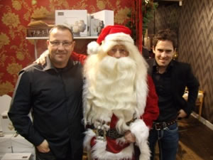 Santa with Greg Abbott Carlisle United Football Club Manager and Player Sean McDaid